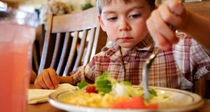 Child Eating Food from Plate