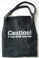 'Caution! I run with knives' apron